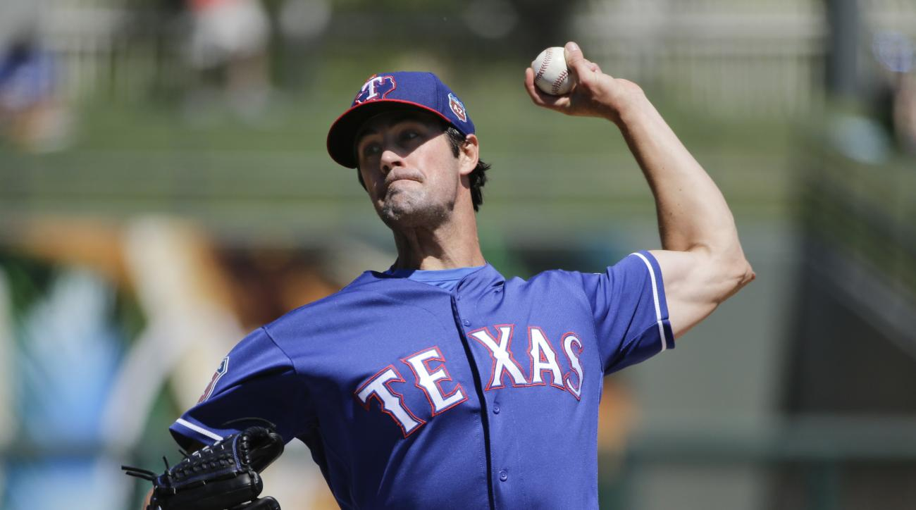 Texas Rangers starting pitcher Cole Hamels throws against the Kansas City Royals during the first inning of a spring training baseball game, Wednesday, March 30, 2016, in Surprise, Ariz. (AP Photo/Jae C. Hong)