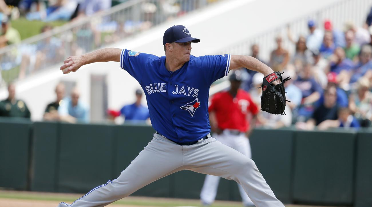 Toronto Blue Jays' Gavin Floyd delivers to the Minnesota Twins in the fourth inning of a spring training baseball game, Wednesday, March 30, 2016, in Fort Myers, Fla. (AP Photo/Tony Gutierrez)