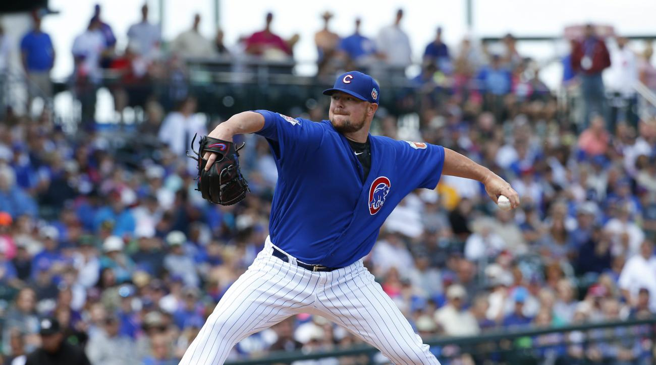 Chicago Cubs pitcher Jon Lester throws during the first inning of a spring training baseball game against the Colorado Rockies, Wednesday, March 30, 2016, in Mesa, Ariz. (AP Photo/Matt York)