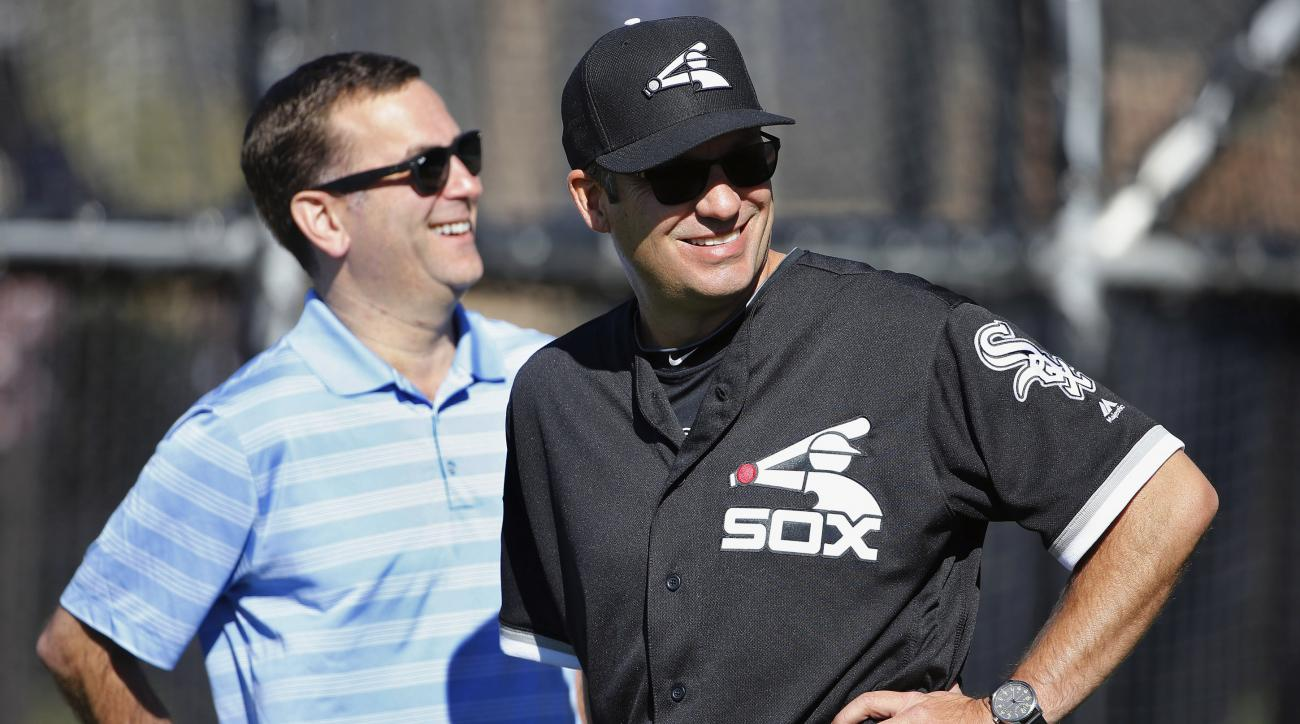FILE - In this Feb. 24, 2016 file photo, Chicago White Sox manager Robin Ventura, right, laughs along with general manager Rick Hahn during a spring training baseball workout in Glendale, Ariz. The White Sox open their regular season Monday night, April 4