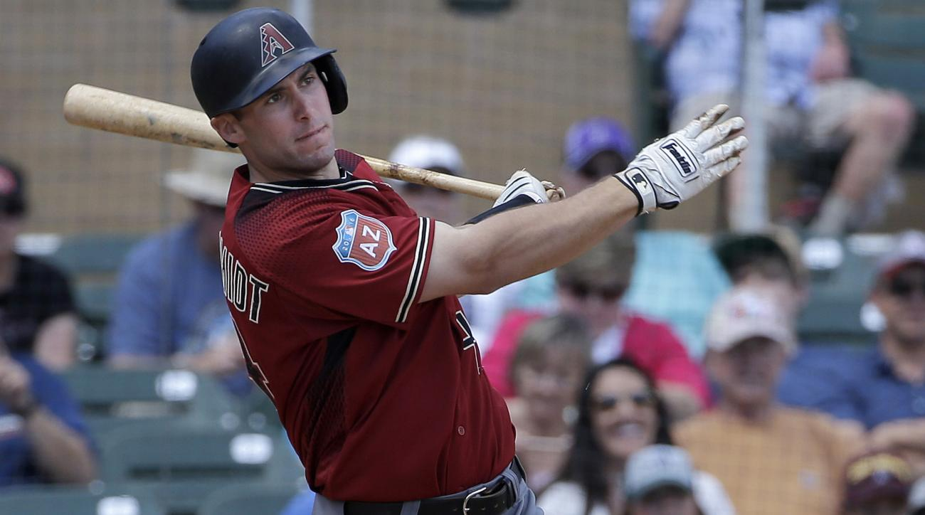 Arizona Diamondbacks' Paul Goldschmidt singles against the Colorado Rockies during the third inning of a spring training baseball game in Scottsdale, Ariz., Thursday, March 31, 2016. (AP Photo/Jeff Chiu)