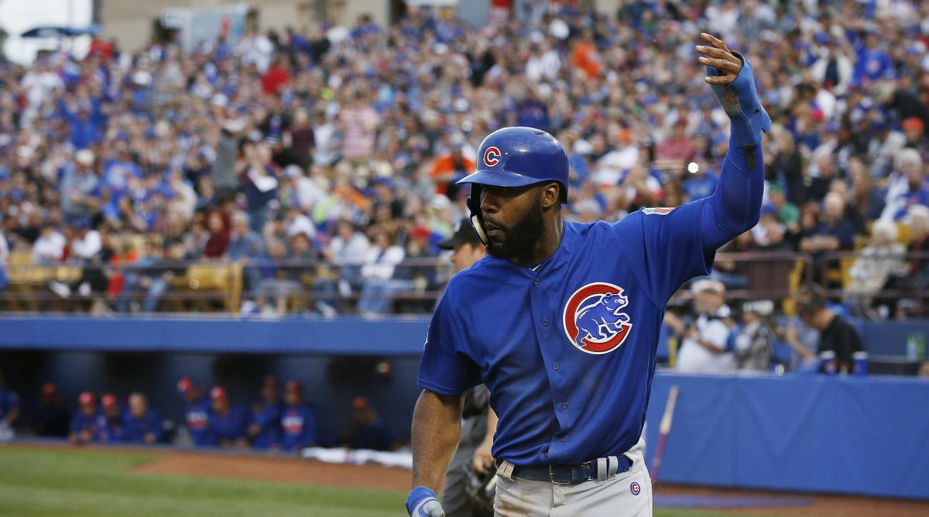 Chicago Cubs' right fielder Jason Heyward celebrates after scoring against the New York Mets in the fifth inning of an exhibition baseball game Thursday, March 31, 2016, in Las Vegas. (AP Photo/John Locher)