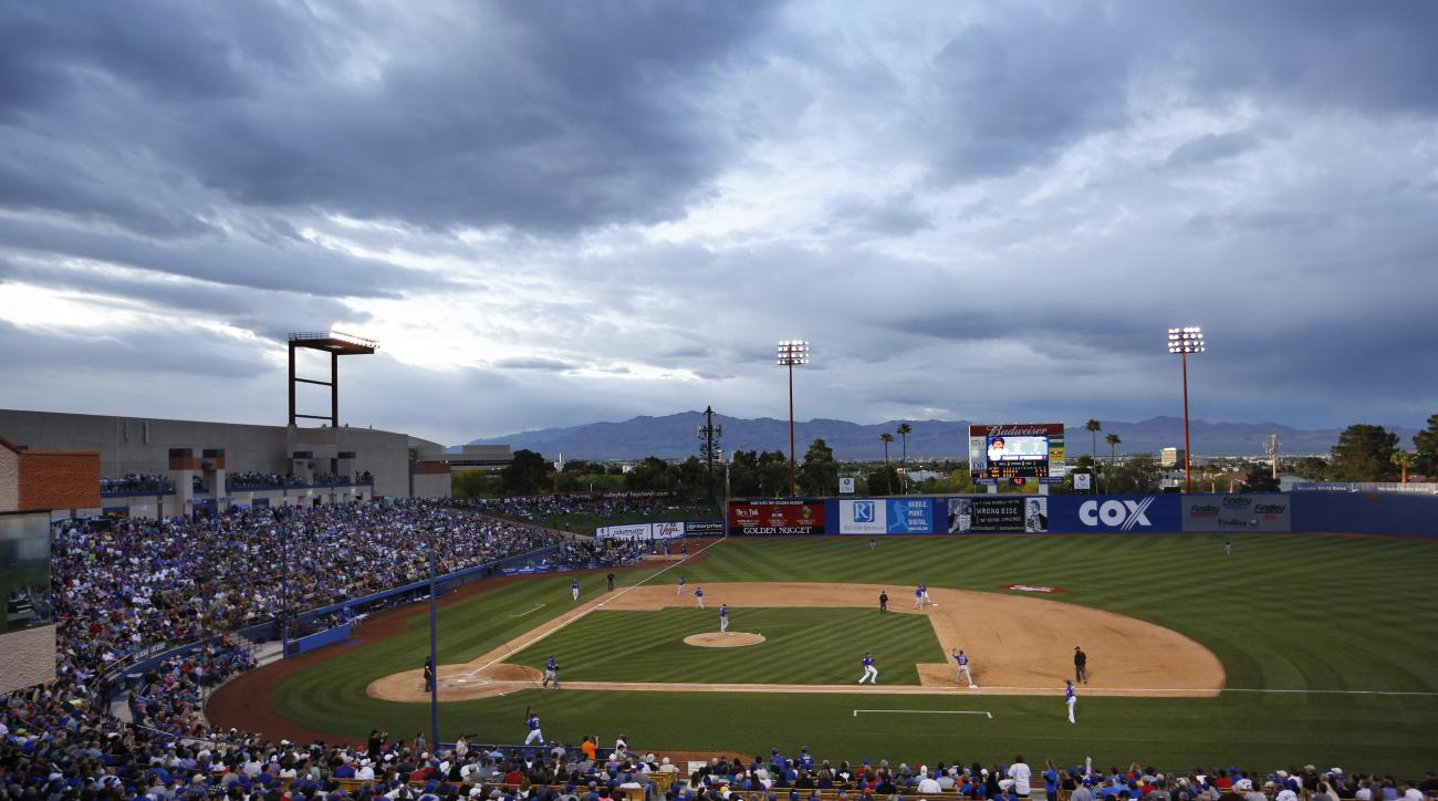 The New York Mets and the Chicago Cubs play an exhibition baseball game, Thursday, March 31, 2016, in Las Vegas. (AP Photo/John Locher)