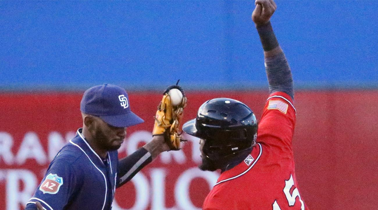 San Diego Padres infielder Alexei Ramirez, left, catches the throw to second base just in time to tag out El Paso Chihuahuas' Yelson Asencio during an exhibition baseball game Thursday, March 31, 2016, in El Paso, Texas. (El Paso Times via AP)
