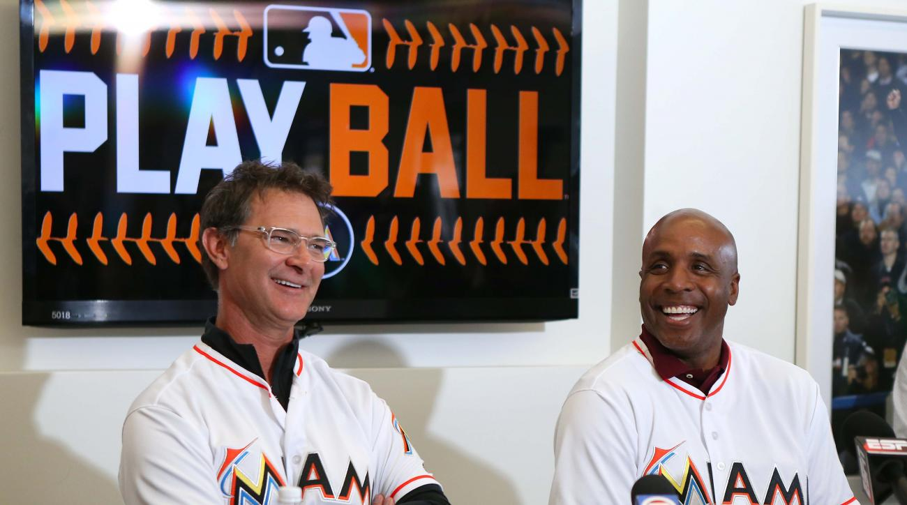 FILE - In this Feb. 20, 2016, file photo, Miami Marlins manager Don Mattingly,left, and hitting coach Barry Bond speaking with the media during the baseball team's FanFest at Marlins Park in Miami. The biggest offseason upgrades were made in the dugout. M