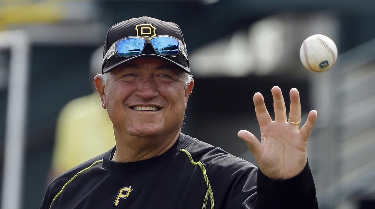 FILE - In this March 11, 2016, file photo, Pittsburgh Pirates manager Clint Hurdle catches a baseball while hitting grounders to his infielders before a spring training baseball game against the Tampa Bay Rays, in Bradenton, Fla. The Pirates are hoping a