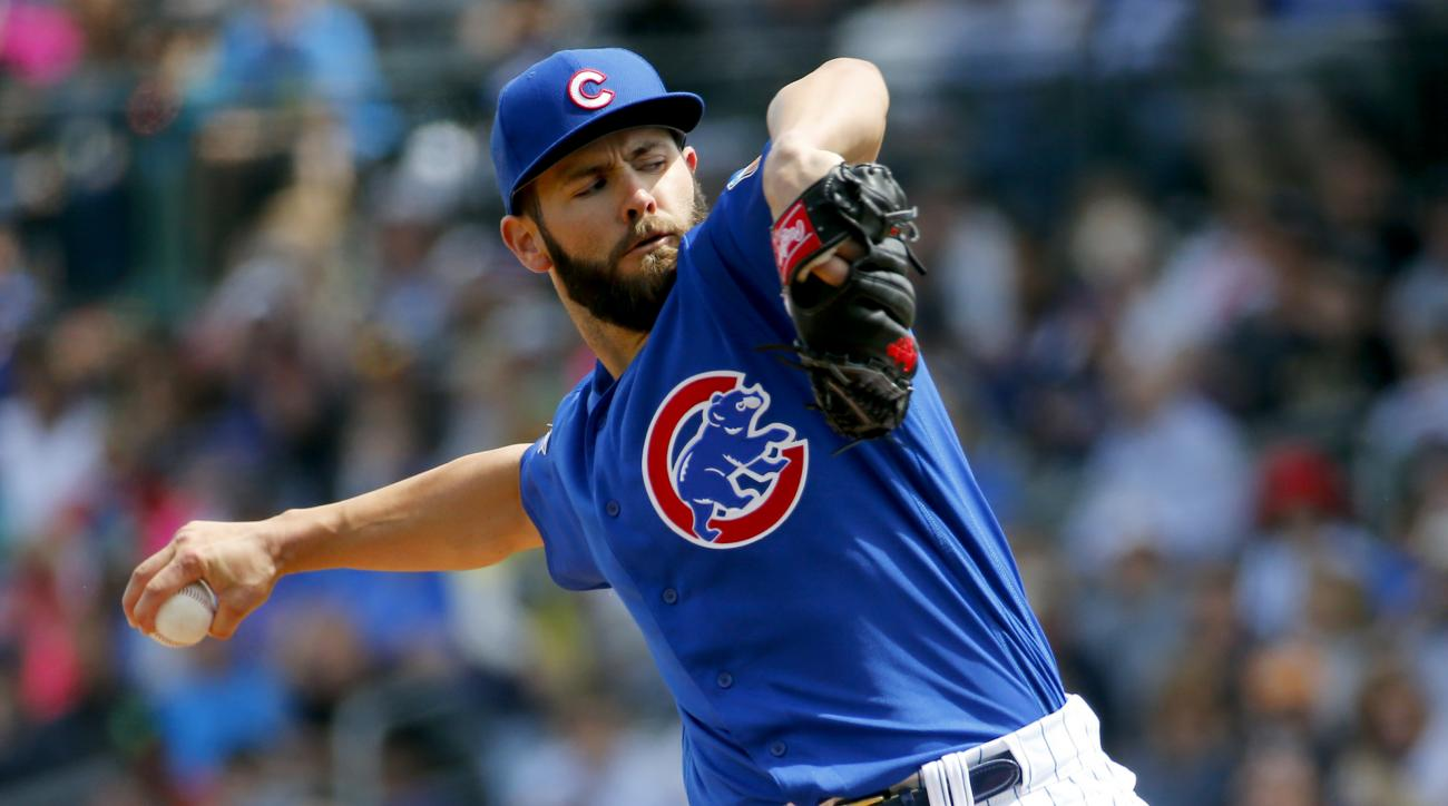 FILE - In this Tuesday, March 29, 2016, file photo, Chicago Cubs pitcher Jake Arrieta throws against the Oakland Athletics during a spring training baseball game in Mesa, Ariz. Arrieta and the Cubs hope to say something about the Giants winning as they di