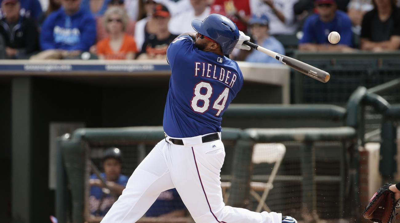 FILE - In this March 7, 2016, file photo, Texas Rangers' Prince Fielder fouls off a pitch against the San Francisco Giants during the first inning of a spring training baseball game in Surprise, Ariz. When Prince Fielder was traded from Detroit to Texas a