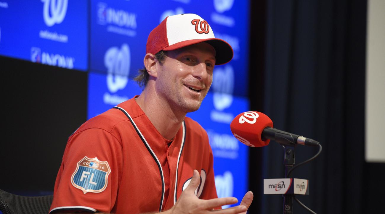 Washington Nationals pitcher Max Scherzer speaks at a press conference before an exhibition baseball game against the Minnesota Twins, Friday, April 1, 2016, in Washington. (AP Photo/Nick Wass)