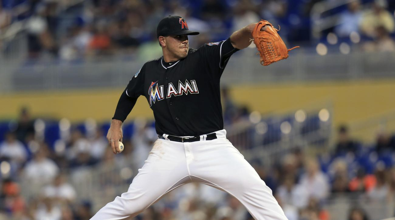 Miami Marlins starting pitcher Jose Fernandez delivers a pitch during the second inning of an exhibition baseball game against the New York Yankees on Friday, April 1, 2016, in Miami, Fla. (AP Photo/Rob Foldy)