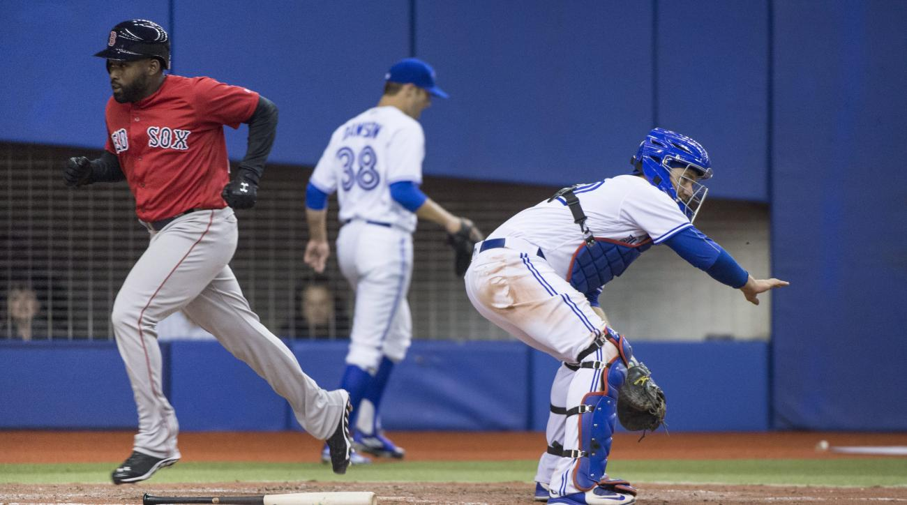 Boston Red Sox's Jackie Bradley Jr. scores past Toronto Blue Jays catcher Josh Thole on an RBI double by teammate Josh Rutledge during the fifth inning of an exhibition baseball game, Saturday, April 2, 2016 in Montreal. (Paul Chiasson/The Canadian Press