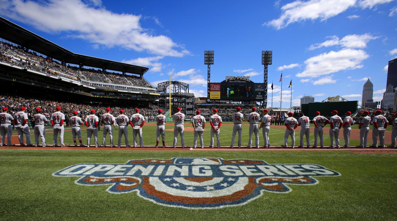 The St. Louis Cardinals stand on the first baseline during team introductions before the first baseball game of the Major League season against the Pittsburgh Pirates at PNC Park in Pittsburgh, Sunday, April 3, 2016. (AP Photo/Gene J. Puskar)