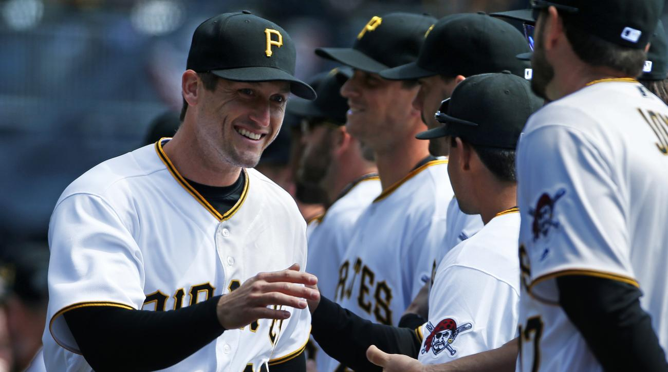 Pittsburgh Pirates' David Freese, left, is introduced before an opening day baseball game against the St. Louis Cardinals in Pittsburgh, Sunday, April 3, 2016. The Pirates won 4-1, with Freese getting the first hit of the Major League season off former te