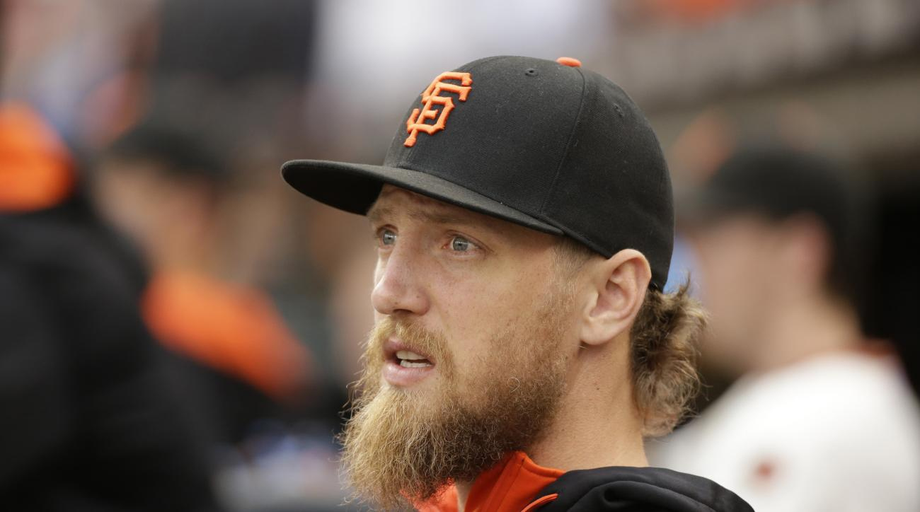 In this photo taken  Sept. 12, 2015, San Francisco Giants' Hunter Pence sits in the dugout during a baseball game against the San Diego Padres in San Francisco. A pair of thieves stole an autographed motorized scooter donated by Pence from the city's Make
