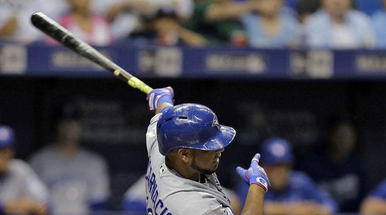 Toronto Blue Jays' Edwin Encarnacion hits a double off Tampa Bay Rays starting pitcher Drew Smyly during the fourth inning of a baseball game Monday, April 4, 2016, in St. Petersburg, Fla. (AP Photo/Chris O'Meara)