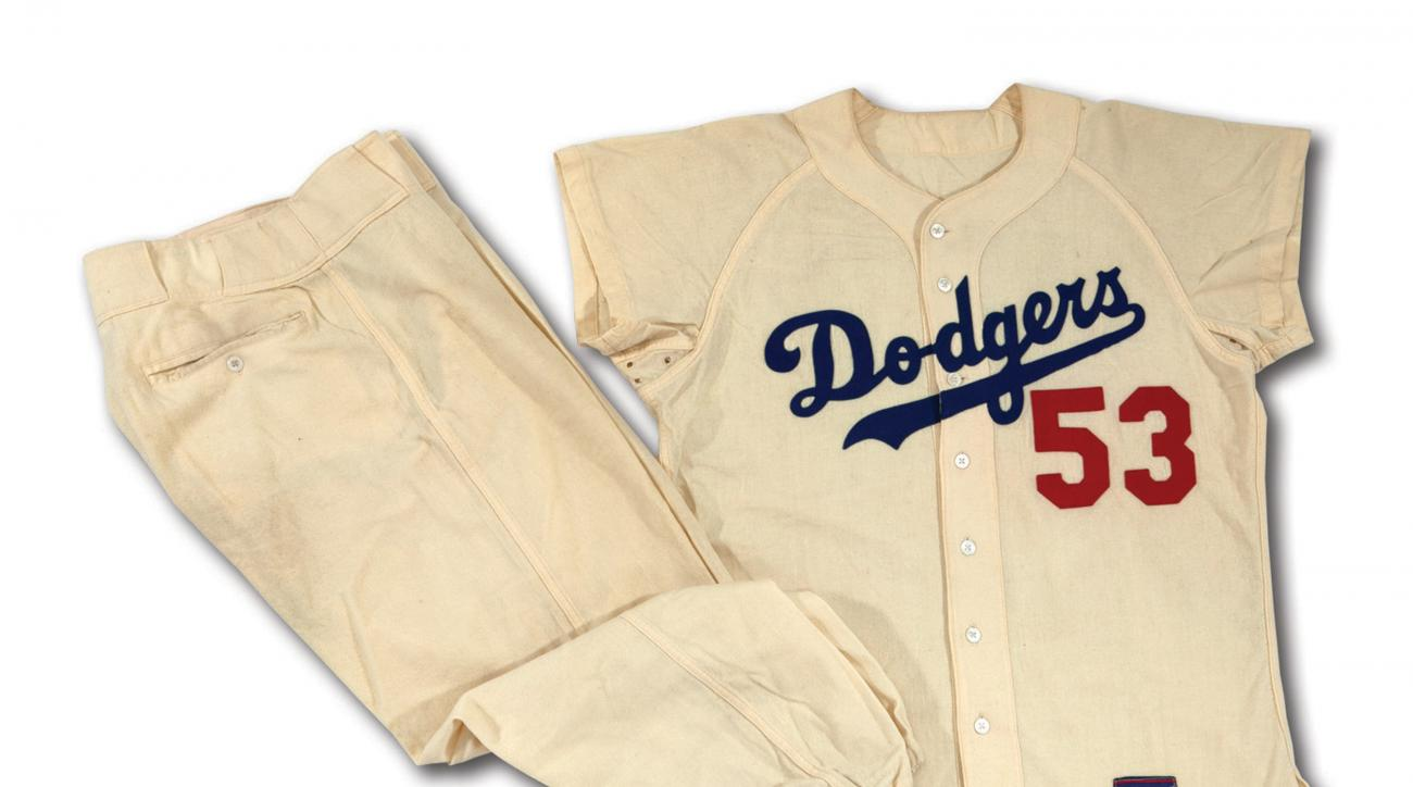 This undated photo provided by SCP Auctions shows former major league pitcher Don Drysdale's 1956 Brooklyn Dodgers home uniform. Ann Meyers Drysdale, the Hall of Fame basketball player who was married to the Hall of Fame pitcher, is putting the items up f