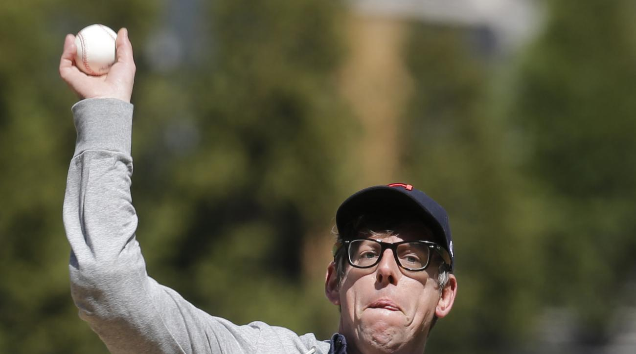 The Black Keys drummer Patrick Carney throws out the ceremonial first pitch before a baseball game between the Boston Red Sox and the Cleveland Indians, Tuesday, April 5, 2016, in Cleveland. (AP Photo/Tony Dejak)