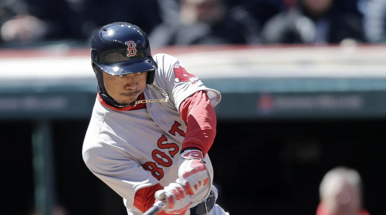 Boston Red Sox' Mookie Betts hits a two-run home run off Cleveland Indians starting pitcher Corey Kluber in the third inning of a baseball game, Tuesday, April 5, 2016, in Cleveland. Jackie Bradley Jr. scored on the play. (AP Photo/Tony Dejak)