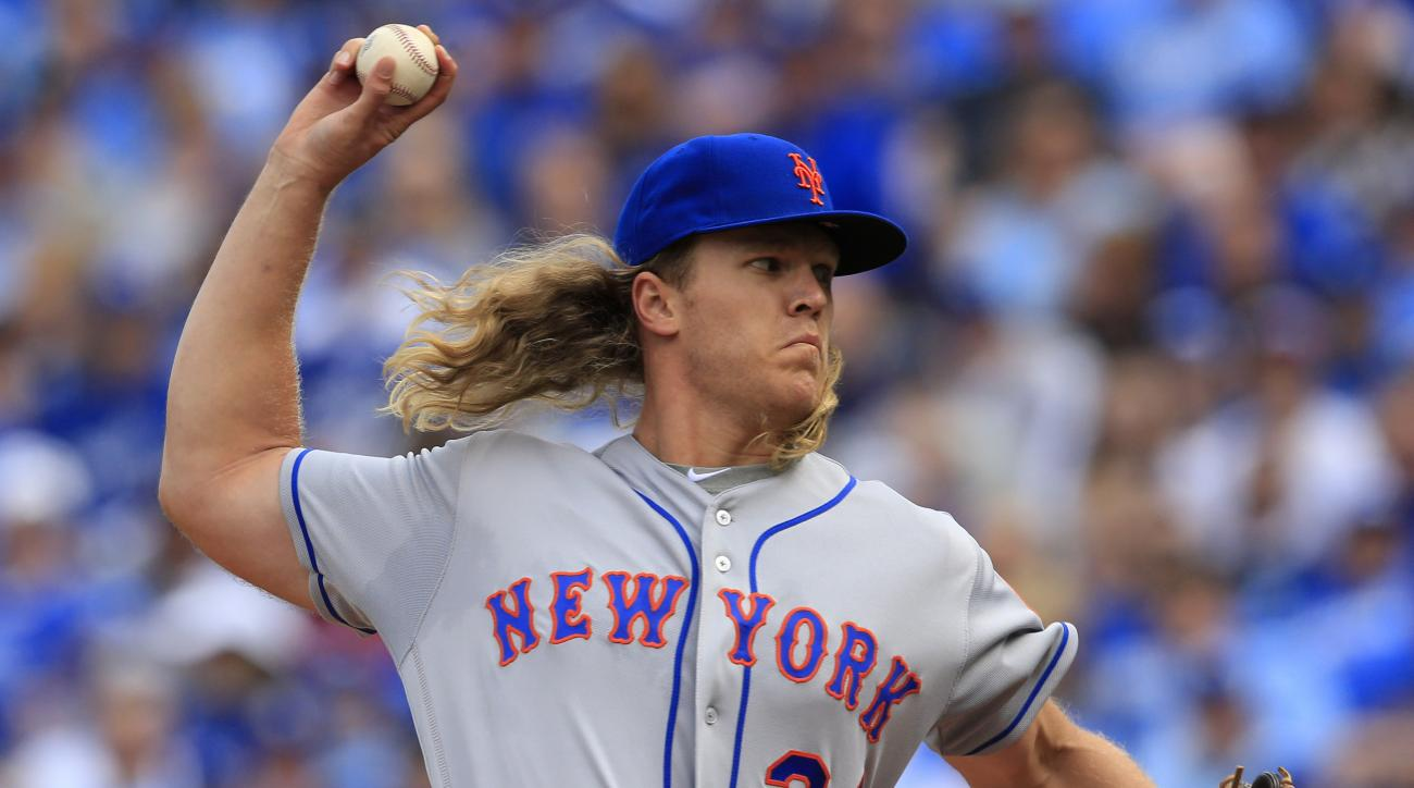 New York Mets starting pitcher Noah Syndergaard delivers to a Kansas City Royals batter during the first inning of a baseball game at Kauffman Stadium in Kansas City, Mo., Tuesday, April 5, 2016. (AP Photo/Orlin Wagner)