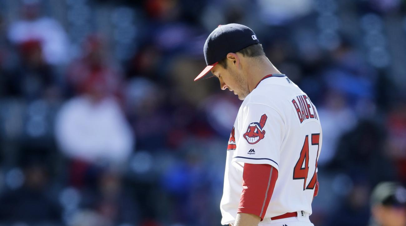 Cleveland Indians relief pitcher Trevor Bauer waits for Boston Red Sox' David Ortiz to run the bases after Ortiz hit a two-run home run off Bauer in the ninth inning of a baseball game, Tuesday, April 5, 2016, in Cleveland. Dustin Pedroia scored on the pl