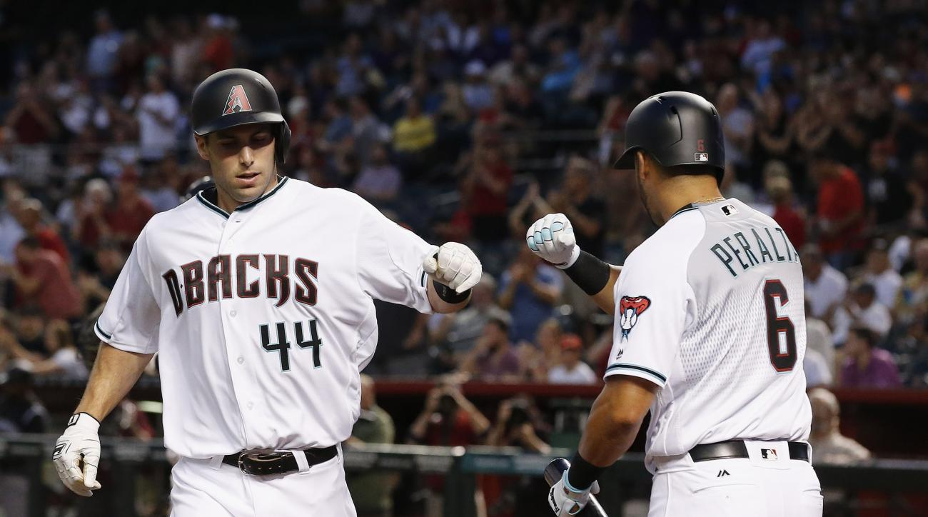 Arizona Diamondbacks' Paul Goldschmidt (44) celebrates his home run against the Colorado Rockies with David Peralta (6) during the first inning of a baseball game Tuesday, April 5, 2016, in Phoenix. (AP Photo/Ross D. Franklin)