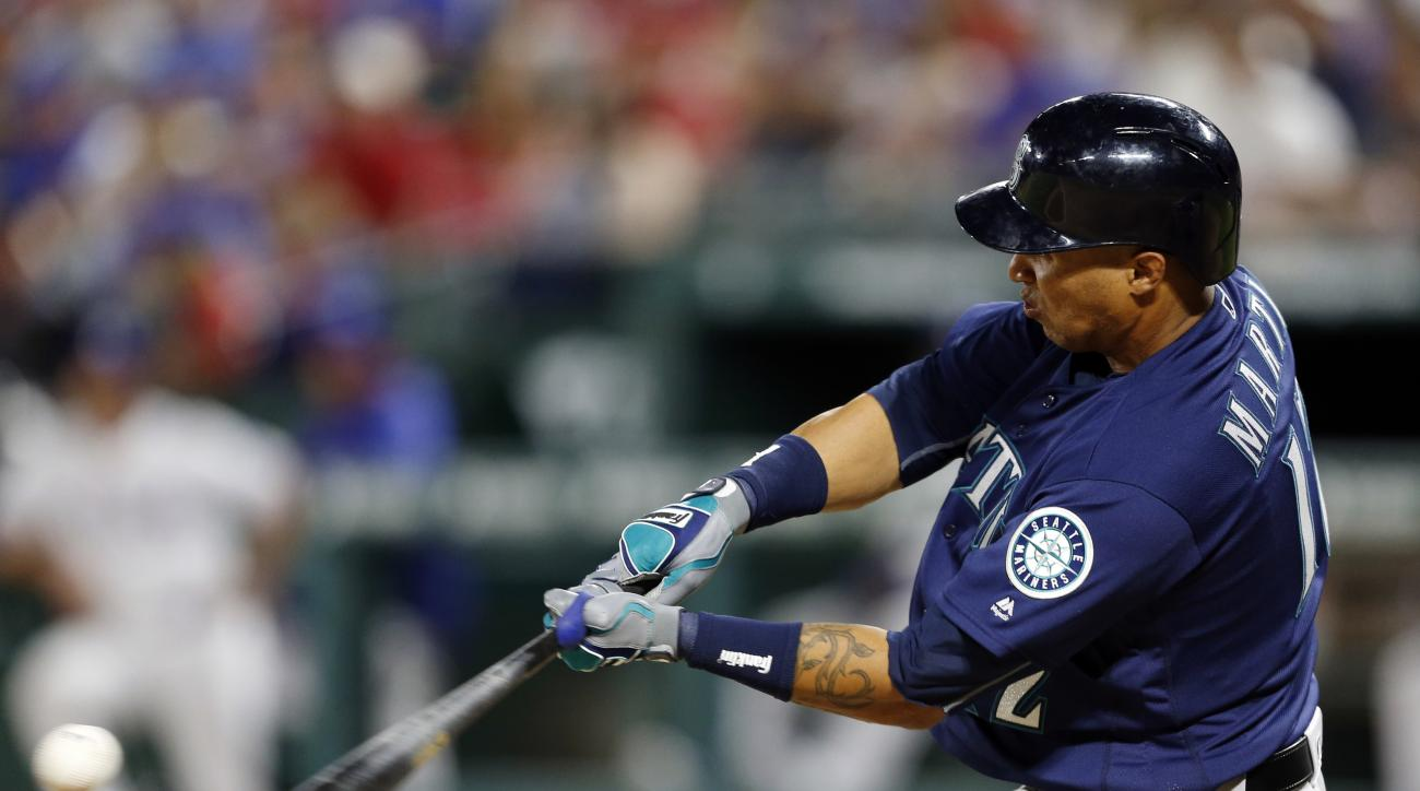 Seattle Mariners' Leonys Martin connects for a run-scoring double to right off a pitch from Texas Rangers relief pitcher Tony Barnette that scored Seth Smith in the seventh inning of a baseball game, Tuesday, April 5, 2016, in Arlington, Texas. Martin rea