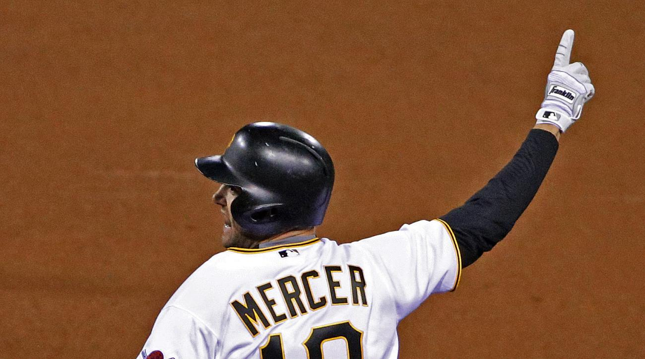 Pittsburgh Pirates' Jordy Mercer (10) celebrates driving in the game-winning run with a single off St. Louis Cardinals relief pitcher Seth Maness during the 11th inning of a baseball game in Pittsburgh, Tuesday, April 5, 2016. The Pirates won 6-5. (AP Pho