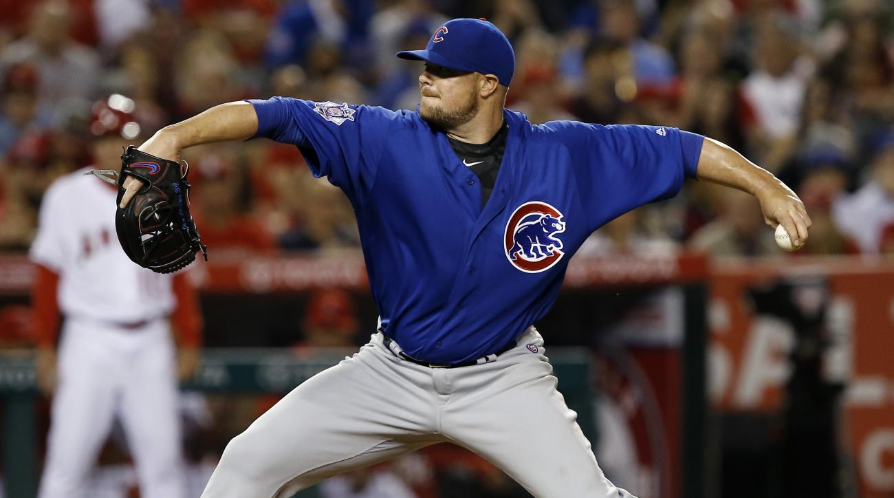 Chicago Cubs starting pitcher Jon Lester throws to the Los Angeles Angels during the sixth inning of a baseball game in Anaheim, Calif., Tuesday, April 5, 2016. (AP Photo/Alex Gallardo)