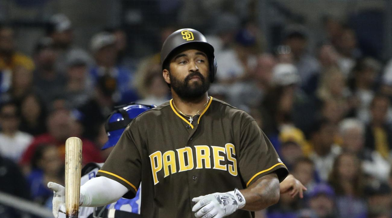 San Diego Padres' Matt Kemp walks away from home plate after striking out in the sixth inning a baseball game against the Los Angeles Dodgers on Tuesday, April 5, 2016, in San Diego. The Dodgers won 3-0. (AP Photo/Lenny Ignelzi)