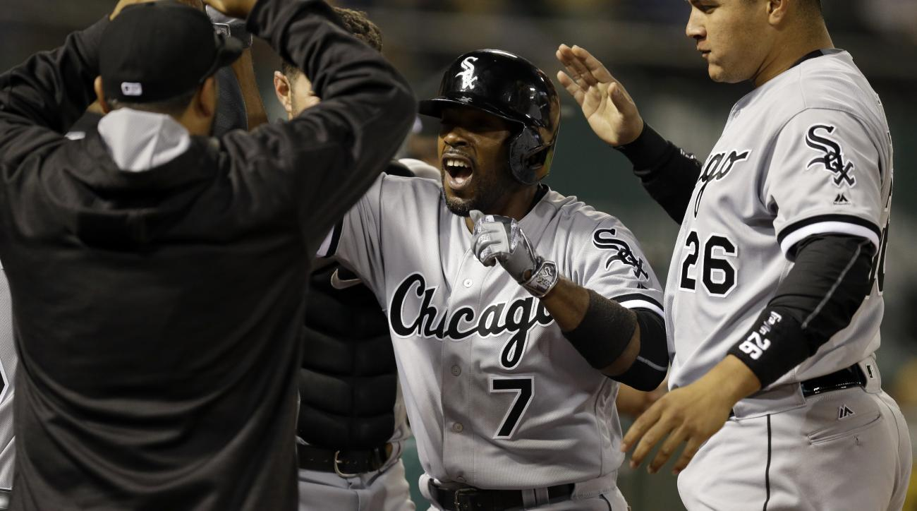 Chicago White Sox's Jimmy Rollins (7) celebrates after hitting a home run off Oakland Athletics' Sean Doolittle during the ninth inning of a baseball game Tuesday, April 5, 2016, in Oakland, Calif. (AP Photo/Ben Margot)