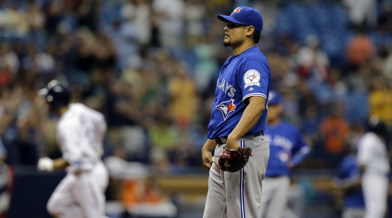 Toronto Blue Jays relief pitcher Arnold Leon waits as Tampa Bay Rays' Steven Souza Jr. runs around the bases after hitting a three-run home run during the eighth inning of a baseball game Wednesday, April 6, 2016, in St. Petersburg, Fla. (AP Photo/Chris O