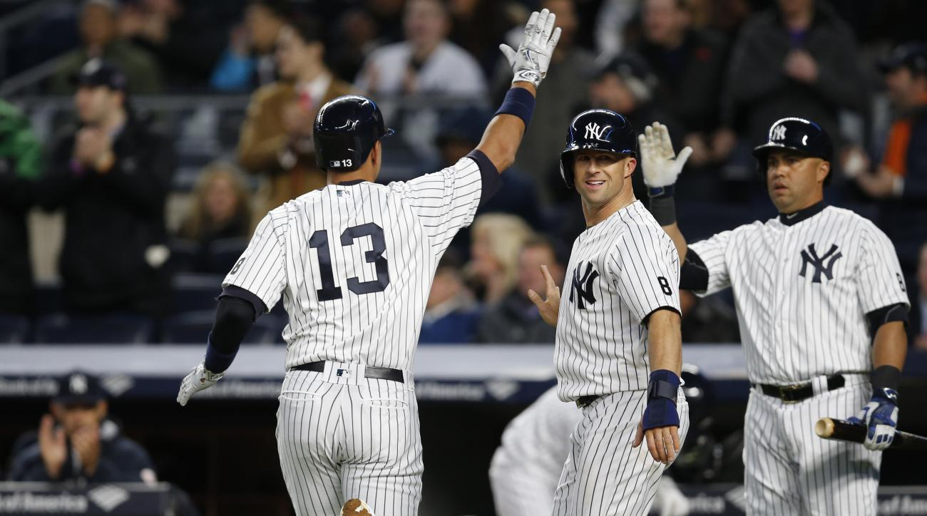 New York Yankees Carlos Beltran, right,and Brett Gardner, center, greet Yankees designated hitter Alex Rodriguez (13) after Rodriguez and Gardner scored on Brian McCann's first-inning, two-run double off Houston Astros starting pitcher Collin McHugh in a