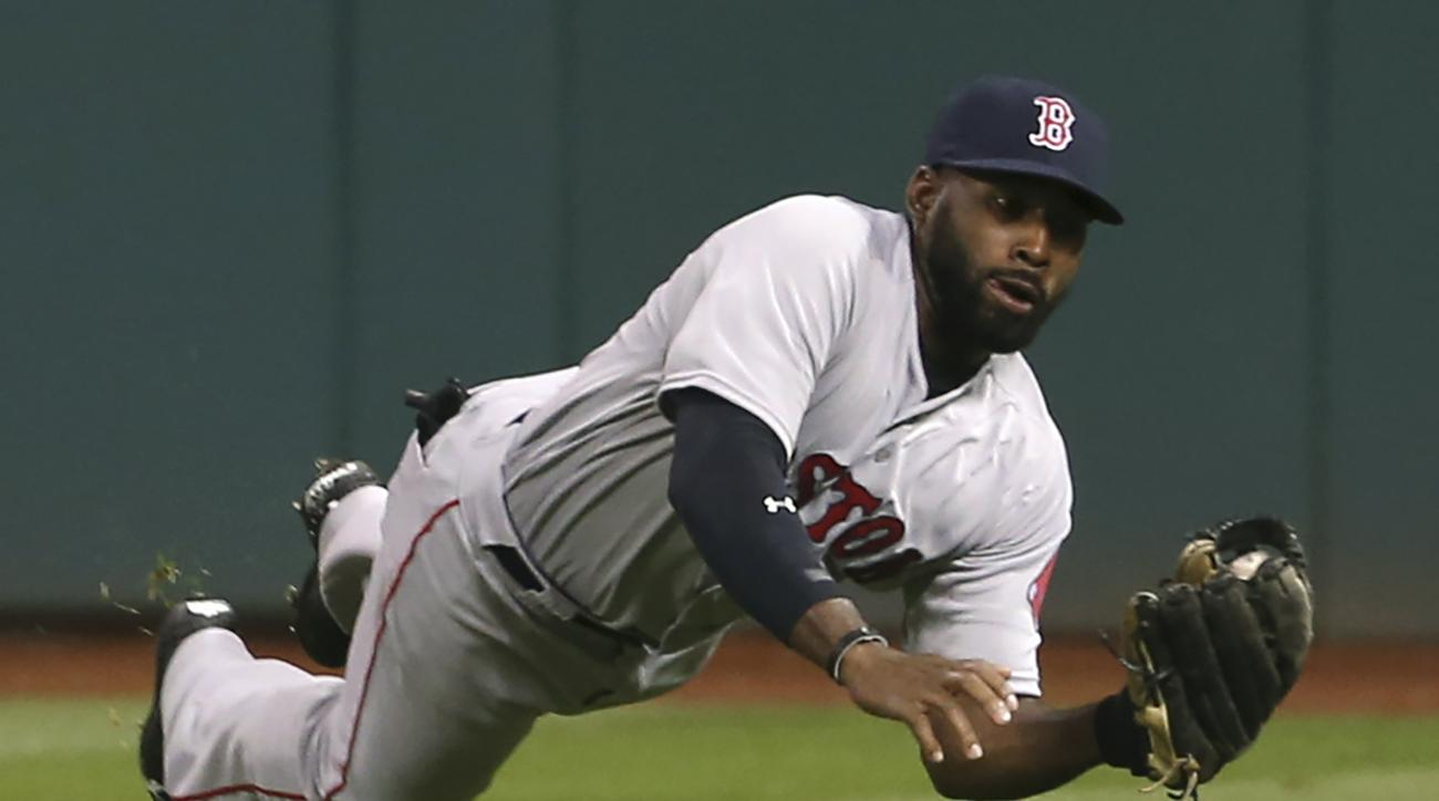 Boston Red Soxs Jackie Bradley makes a diving catch of a ball hit by Cleveland Indians' Yan Gomes during the seventh inning of a baseball game, Wednesday, April 6, 2016, in Cleveland. (AP Photo/Ron Schwane)