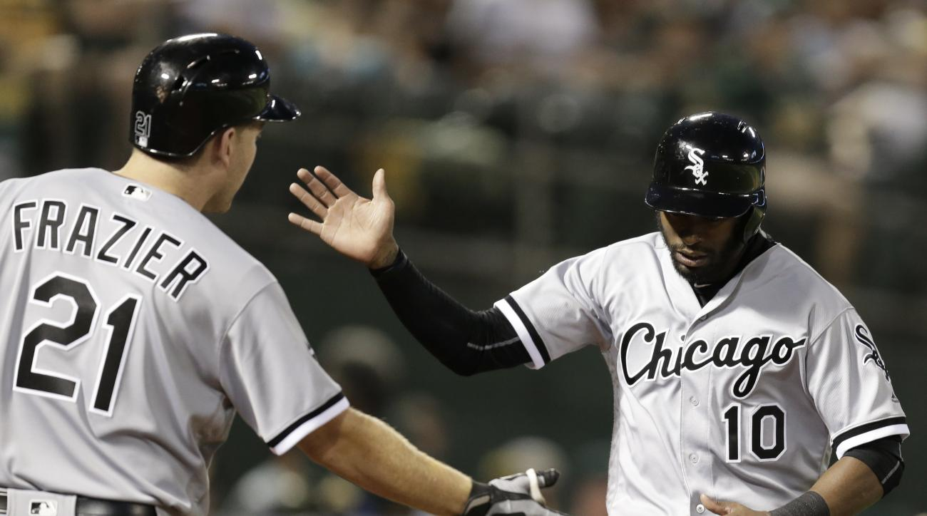 Chicago White Sox's Austin Jackson, right, celebrates with Todd Frazier (21) after scoring against the Oakland Athletics during the third inning of a baseball game Wednesday, April 6, 2016, in Oakland, Calif. Jackson scored on a sacrifice fly by sacrifice