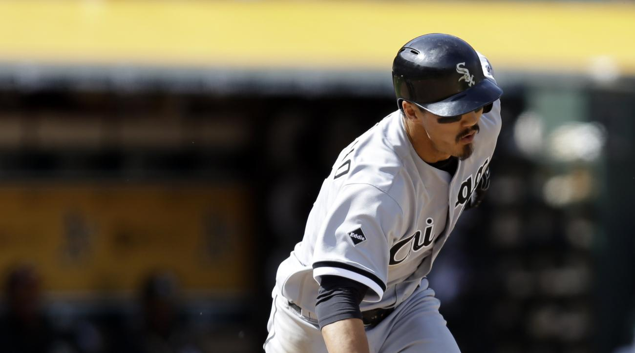 Chicago White Sox's Tyler Saladino drops his bat after hitting an RBI single off Oakland Athletics' Liam Hendriks in the ninth inning of a baseball game Thursday, April 7, 2016, in Oakland, Calif. (AP Photo/Ben Margot)