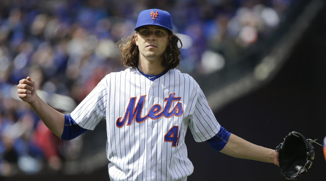 New York Mets pitcher Jacob deGrom (48) reacts as he walks off the field at the end of the top of the sixth inning after giving up the tying run to the Philadelphia Phillies during a baseball game, Friday, April 8, 2016, in New York. (AP Photo/Julie Jacob