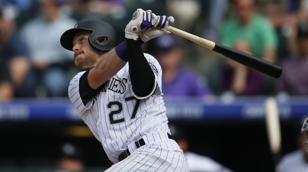 Colorado Rockies' Trevor Story follows the flight of his three-run home run off San Diego Padres starting pitcher Colin Rea in the fourth inning of a baseball game Friday, April 8, 2016, in Denver. (AP Photo/David Zalubowski)