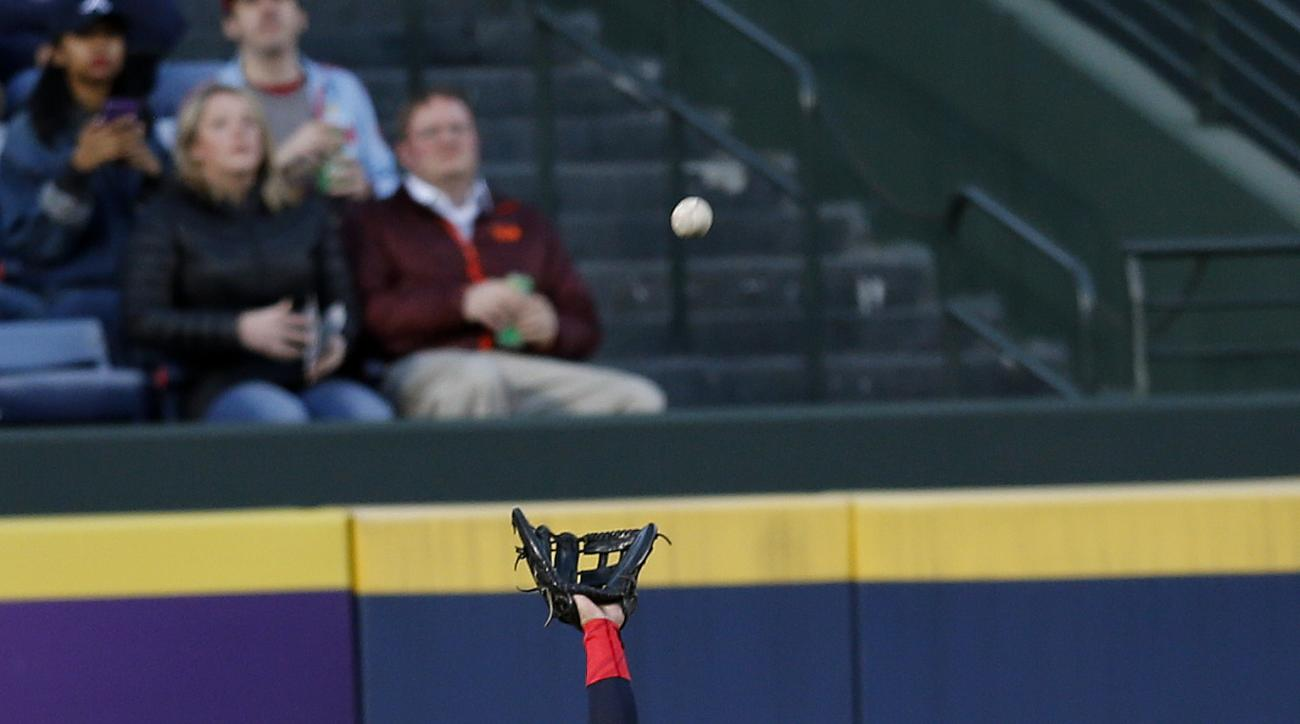 Atlanta Braves center fielder Ender Inciarte (11) gets under a fly ball off the bat of St. Louis Cardinals' Matt Carpenter in the first inning of a baseball game Friday, April 8, 2016, in Atlanta. (AP Photo/John Bazemore)