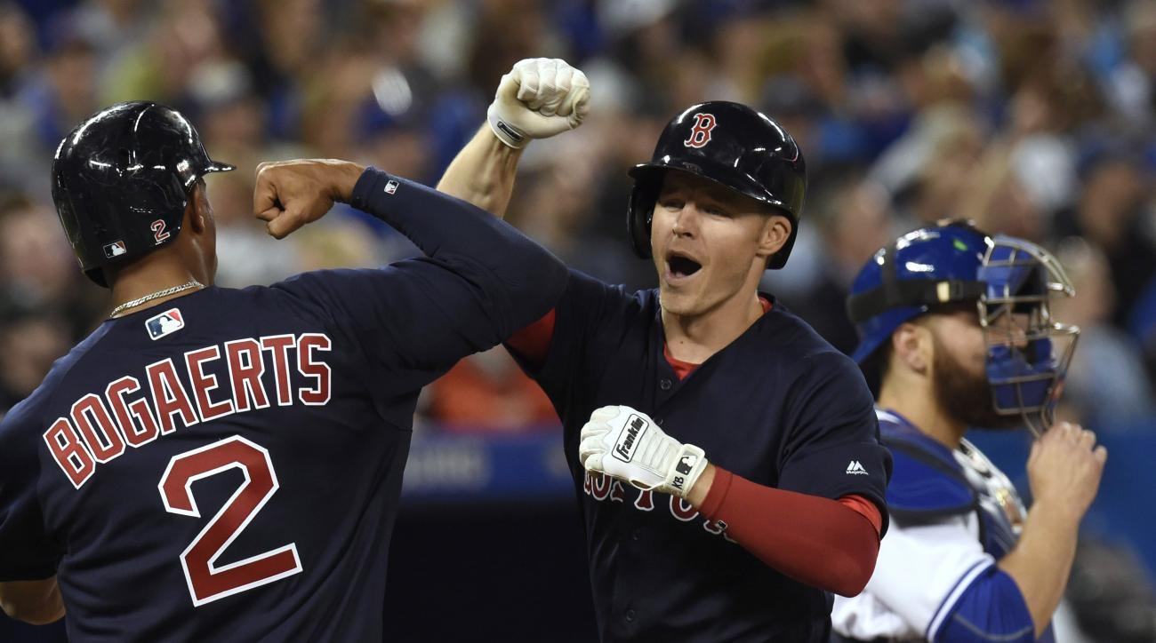 Boston Red Sox's Brock Holt celebrates with teammate Xander Bogaerts after hitting a grand slam against the Toronto Blue Jays during the sixth inning of a inning of a baseball game Friday, April 8, 2016, in Toronto. (Frank Gunn/The Canadian Press via AP)