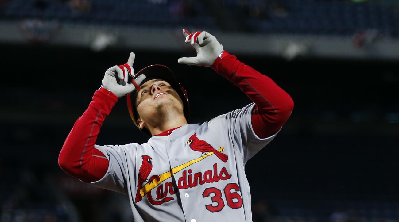 St. Louis Cardinals' Aledmys Diaz (36) points skyward as he crosses home plate after hitting a home run in the seventh inning of a baseball game against the Atlanta Braves Friday, April 8, 2016, in Atlanta. St. Louis won 7-4. (AP Photo/John Bazemore)