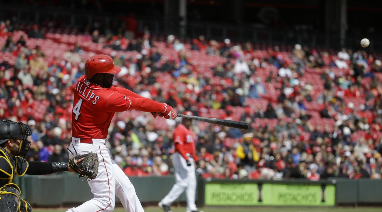 Cincinnati Reds' Brandon Phillips hits an RBI single off Pittsburgh Pirates starting pitcher Gerrit Cole in the fifth inning of a baseball game, Saturday, April 9, 2016, in Cincinnati. (AP Photo/John Minchillo)