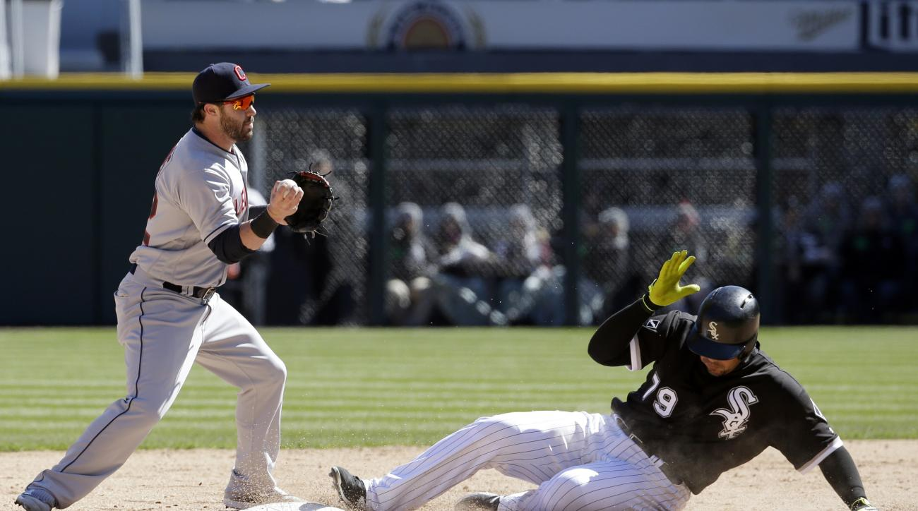 Cleveland Indians second baseman Jason Kipnis, left, looks to first base after forcing out Chicago White Sox's Jose Abreu during the seventh inning of a baseball game Saturday, April 9, 2016, in Chicago. Todd Frazier was safe at first base. (AP Photo/Nam