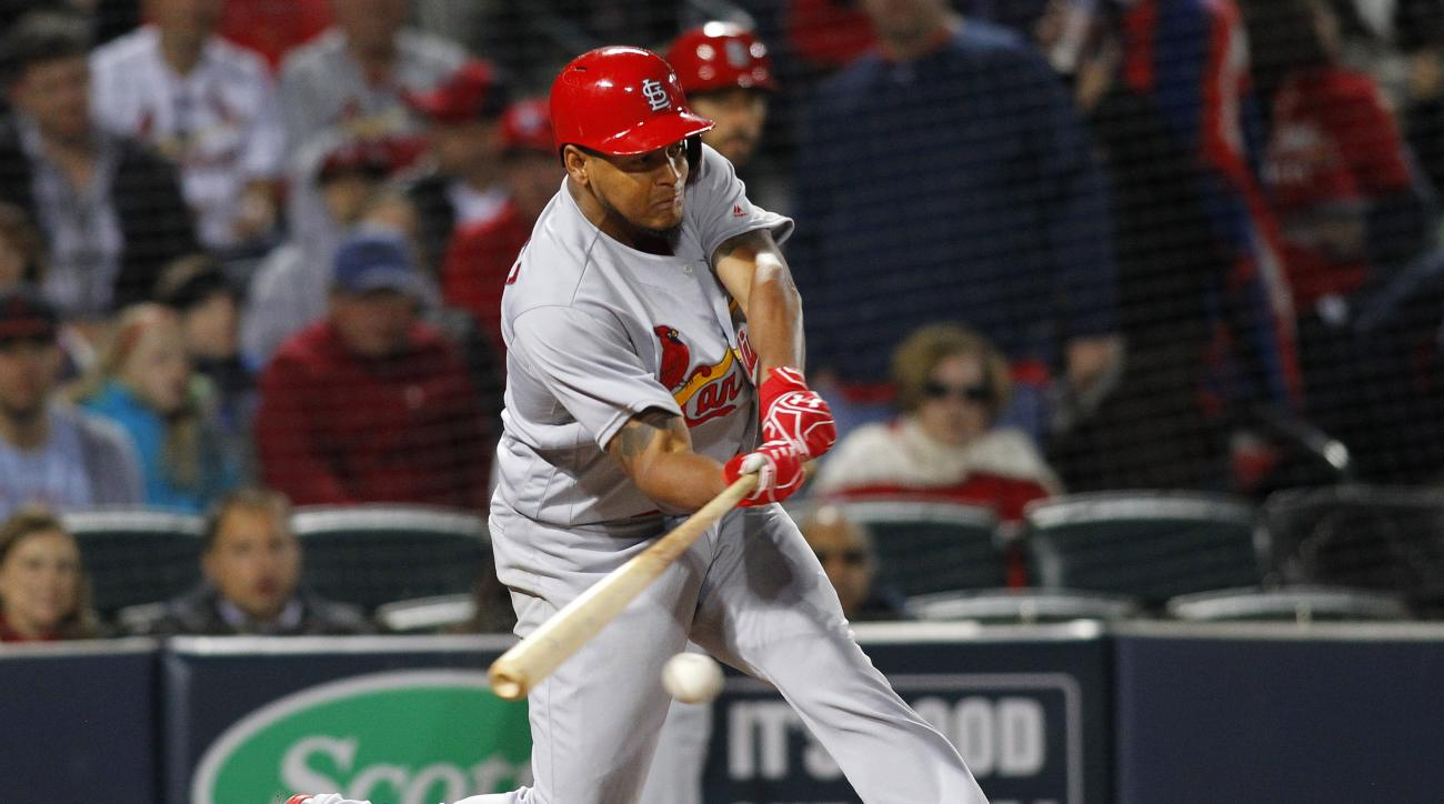 St. Louis Cardinals' Carlos Martinez hits an RBI single scoring Kolten Wong in the fifth inning of a baseball game against the Atlanta Braves, Saturday, April 9, 2016, in Atlanta. (AP Photo/Brett Davis)