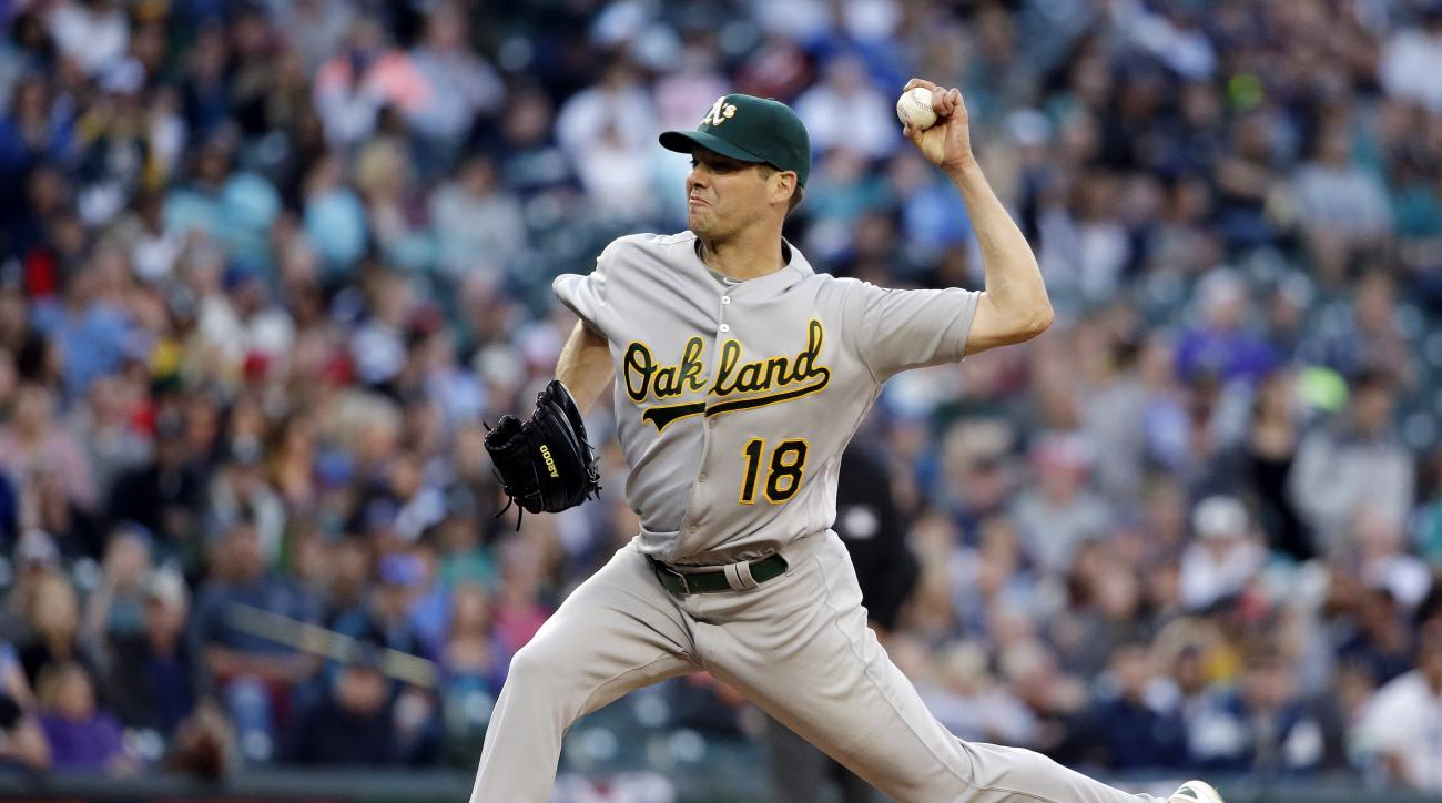 Oakland Athletics starting pitcher Rich Hill throws against the Seattle Mariners in the third inning in a baseball game Saturday, April 9, 2016, in Seattle. (AP Photo/Elaine Thompson)