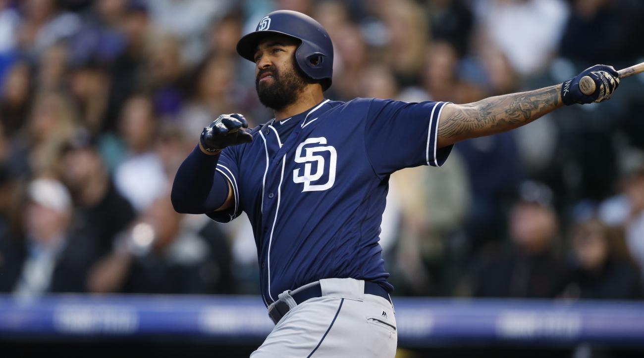 San Diego Padres' Matt Kemp follows the flight of his solo home run off Colorado Rockies starting pitcher Jorge De La Rosa in the third inning of a baseball game Saturday, April 9, 2016, in Denver. (AP Photo/David Zalubowski)