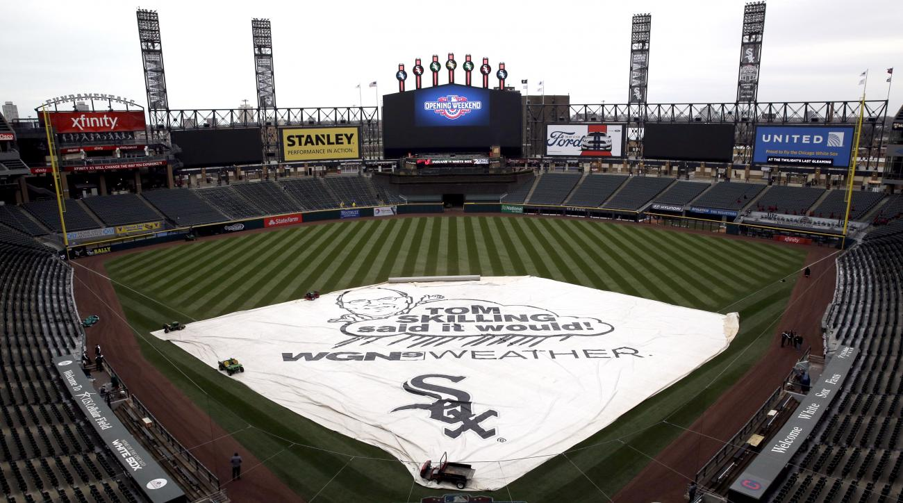 The tarp covers the infield before a baseball game between the Chicago White Sox and the Cleveland Indians, Sunday, April 10, 2016, in Chicago. (AP Photo/Nam Y. Huh)