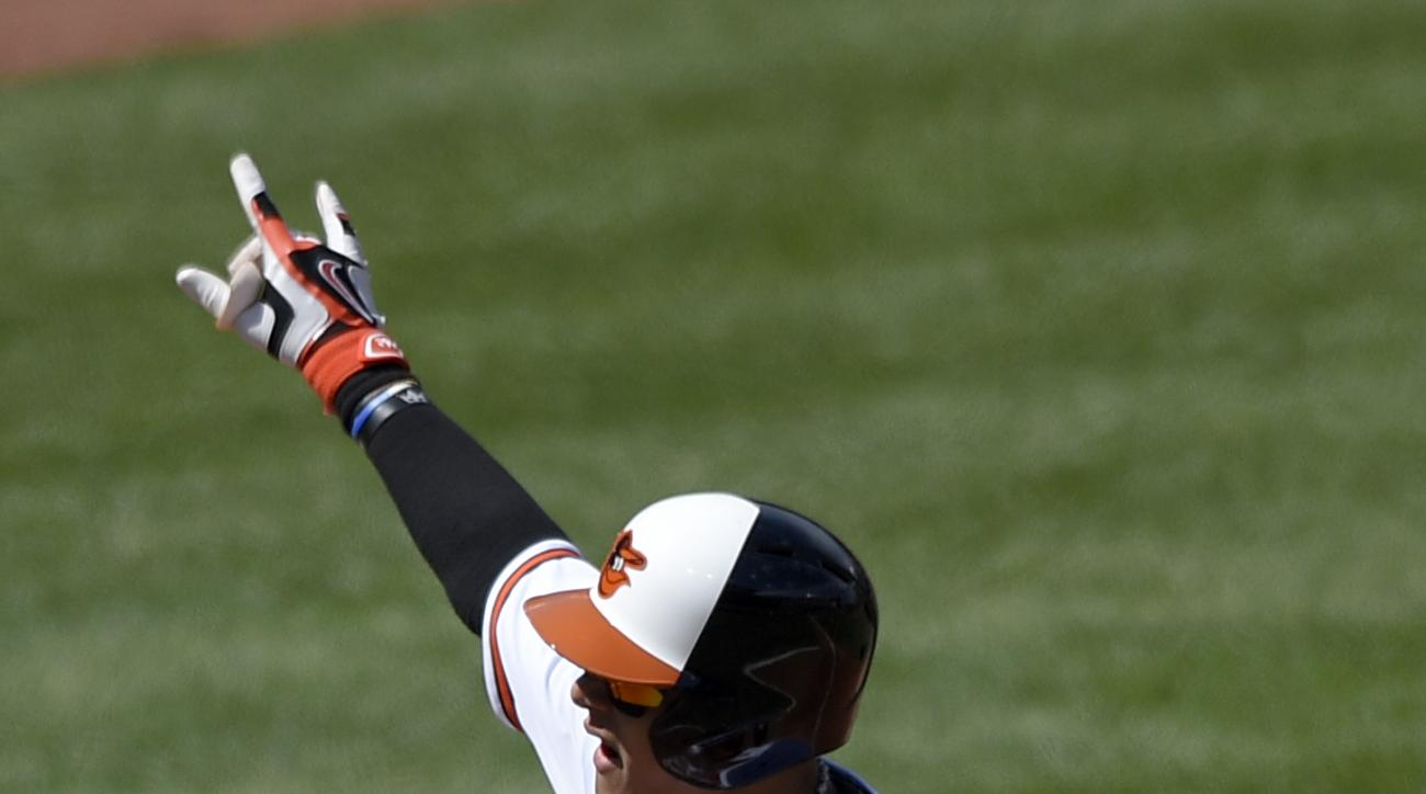 Baltimore Orioles' Manny Machado celebrates his two-run home run against the Tampa Bay Rays during the second inning of an baseball game, Sunday, April 10, 2016, in Baltimore. (AP Photo/Nick Wass)