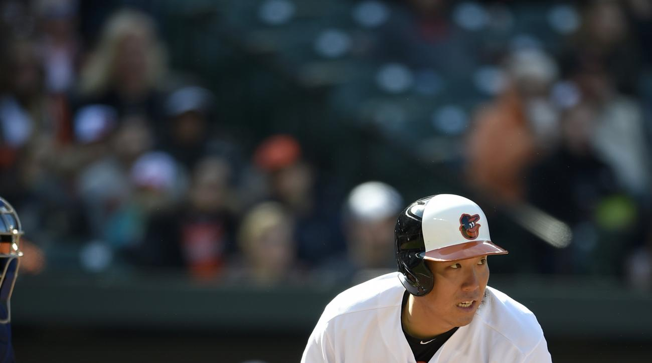 Baltimore Orioles' Hyun Soo Kim, of South Korea, watches his single during the seventh inning of an baseball game against the Tampa Bay Rays, Sunday, April 10, 2016, in Baltimore. The Orioles won 5-3. (AP Photo/Nick Wass)