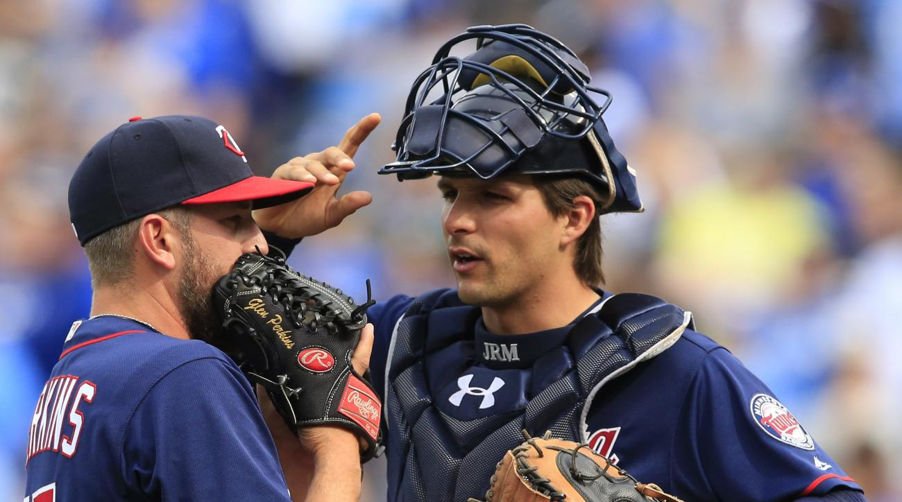 Minnesota Twins catcher John Ryan Murphy, right, talks with relief pitcher Glen Perkins (15) during the ninth inning of a baseball game against the Kansas City Royals at Kauffman Stadium in Kansas City, Mo., Sunday, April 10, 2016. Perkins gave up two run
