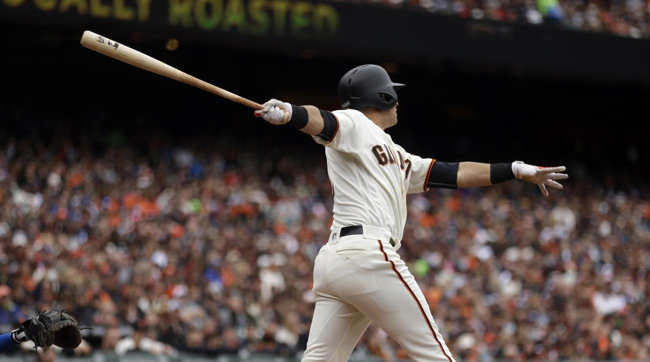 San Francisco Giants' Joe Panik swings for a two-run double in the sixth inning of a baseball game against the Los Angeles Dodgers, Sunday, April 10, 2016, in San Francisco. (AP Photo/Ben Margot)